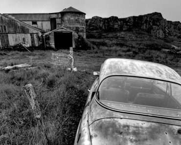 Abandoned Car and Building
