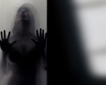 Ghostly figure at door